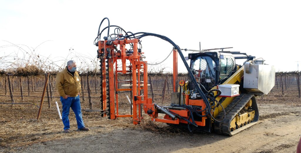 Craig Edwards explains the Spagnolo pre-pruning equipment customized for LangeTwins Vineyards. Photo by Stephanie Bolton.